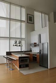 reforma cocina abierta en loft con distribuci³n en U suelo de