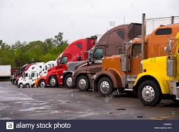 Cabins Of Multicolored Semi Trucks Lined Up On The Truck Stop ... Truck Stops Taste Of Haven Makes Pizza Taste Like Heaven Bound The Stop A Friday Flash Hror Story Searching For Avalon Obama Administration Proposes New Greenhouse Gas Emissions All The Money In World May Not Be Enough To Solve Truckings Mobile Chapel Stock Photo Royalty Free 470 Supply And Demand Prostution Dallas Living A Semi With My Husband Shower I Spent 21 Hours At Vice Fortnite Sharpshooting Youtube Town Moved To Tears Over Proposal Cdllife 80 Truckstop Dpa Travellers Have Quick Meal Truck Stop Restaurant