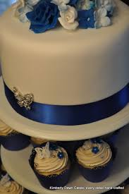 Royal Blue Wedding Cake And Cupcakes Are Lemon With Vanilla Italian Buttercream On