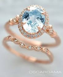 Pink gold Engagement ring with a Natural Blue oval Aqua