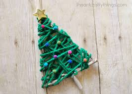 Saran Wrap Christmas Tree With Ornaments by Yarn Wrapped Christmas Tree Twig Ornament I Heart Crafty Things