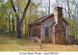 An old cabin in the woods A rustic but scenic old cabin stock