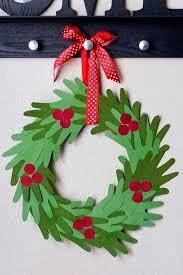 Make This Adorable And Inexpensive Christmas Hand Print Wreath With Your Kids Its