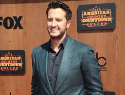 100 Luke Bryan We Rode In Trucks Crowned Male Vocalist Of The Year At American Country