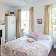 Unique Metal Bed And Beige Curtain For Nice Bedroom Ideas With Classic White Fireplace