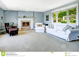 light blue living room with white sofa and fireplace stock image