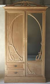 Art Nouveau Armoire - France, Early 20th Century At 1stdibs Emejing Armoire Art Deco Photos Transfmatorious Midcentury With Cedar Closet By Tribond Voyage Of An Kindredvoyages Sold Italian 1930s Vintage Wardrobe Or B491 Mahogany Cpactom Fitted Beautiful Burl Bakelite Handles At 1stdibs French Nouveau Maple And Inlaid Armoire Tanguy 1931 The Proteus Yves Pinterest Old World Complete In Warm Pomegranate English Faux Bamboo On Chairishcom Biscayne