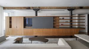 100 11 Wood Loft Office Of Architecture Swaps Walls For Walnut Furniture In