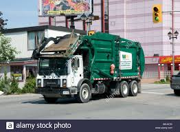 A Mack Garbage Truck Passes Through Down Town Niagara Falls, Ontario ...