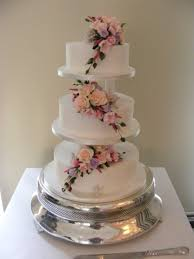 Grace Classic Royal Iced And Pillared Wedding Cake With Wired Sprays Of Pastel Sugar Flowers