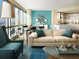 breathtaking cream sleeper couch and teal wall painted as well as