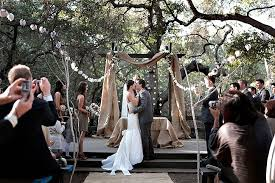 A Ceremony Arch Made With Bookcases Via 100 Layer Cake