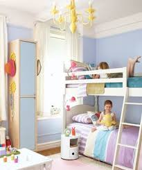 Two Girls On Bunk Beds In An Organized Clean Childrens Room