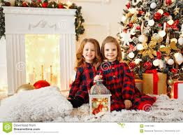 Download Girls Under Christmas Tree Stock Image Of Festive