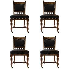 Lambs Of Manchester A Set Four Aesthetic Movement Oak Leather Dining Chairs For Sale