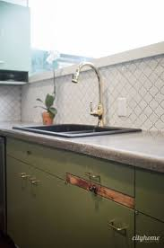 Mid Century Modern Kitchen Green Cabinets Concrete Counters White Tile Backsplash Original Cutting Board Brass Fixtures