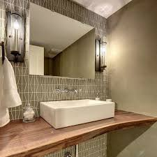 a gorgeous powder room featuring the glass mosaic from