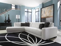 Interior Decorations Inspiration Picturesque White Vinyl L Shapes Tufted Sectional Black Cushions As Well Shade Table Lamps In Modern Living Room