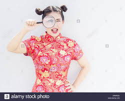 asian lady in chinese cheongsam dress use manifier to find