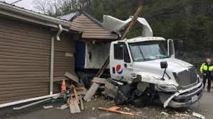 Pepsi truck slams into funeral home