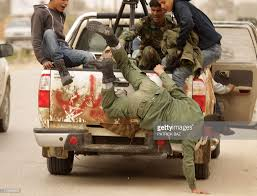 100 Coastal Truck Driving A Fleeing Libyan Rebel Falls From A Truck Driving Back To The