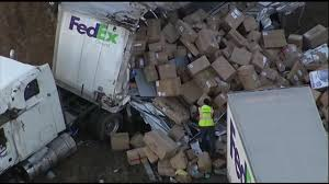 FedEx Truck Spills Packages After Overturning On NJ Highway ...