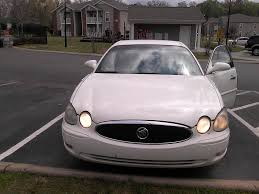 2006 buick lacrosse headlights low beams go intermittently