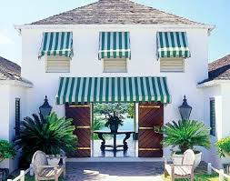 This Has Blue White Stripped Awnings And The Door Tropical Plants