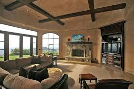 Rustic Living Room With Limestone Tile Floors Exposed Beam Casual Two Tone Sofa