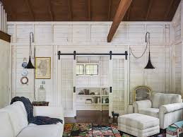 Interior Barn Doors Living Room Rustic With Built In Bookshelves Beams