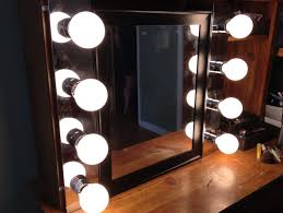 awesome mirror with lights around it
