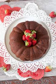 Lower calorie low sugar made with dark chocolate cake with strawberries and yogurt