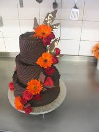 3 Tier Wicked Chocolate Wedding Cake Iced In Spanish Textured Ganache Decorated With Orange