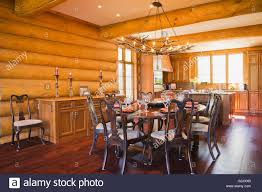 Round Wooden Dining Room Table 8 Chairs Kitchen Inside A Luxurious Cottage Style Log Home Quebec Canada This Image Property