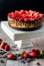 Chocolate Covered Strawberry Cheesecake chocolate cookie crust a layer of chocolate ganache topped