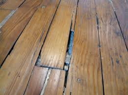 Wood Floor Leveling Filler by Problems With Wood Filler How Not To Fill Gaps In Hardwood Floors