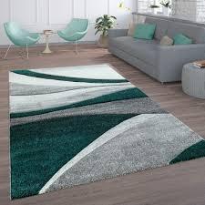 wohnzimmer teppich wellen linien grau grün