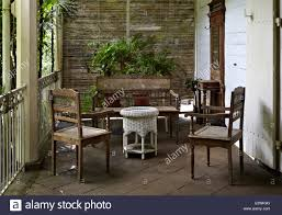 Table And Chairs On Veranda Of La Maison Creole A French Colonial House Also Known As Eureka Or 109 Doors In Moka