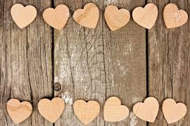 Valentines Day Wooden Hearts Forming A Double Border On Rustic Wood Background Stock Photo