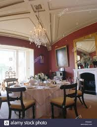 Antique Chairs At Table Set For Lunch With White Linen Cloth In Red Country Dining Room Vaulted Ceiling