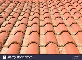 terracotta roof tiles on the roof of a building stock photo