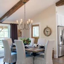 Open Concept Dining Room With Exposed Beam Vaulted Ceilings