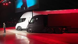 Tesla Launches Electric Truck With Big Power And Range | News Tesla In Spotlight With Beast Electric Semitruck Elon Musk On The Electric Pickup Truck How About A Mini Semi Get Ready For Pickup And Heavyduty Truck Looks Like New Iepieleaks Vows To Build Right After Model Y Sued 2 Billion By Hydrogen Startup Over Alleged Leaked Image Of Spxmasterrace Plans Sell Trucks Big Semis Pickups Too Extremetech Just Received Its Largest Preorder Yet The Verge Teslas Said Companys Semi Will Reveals Roadster
