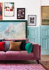 boho vibes pink velvet sofa with velvet cushions blue wall