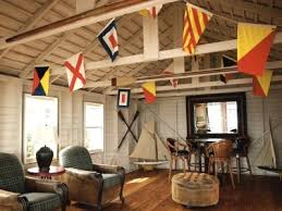 In This Rustic Living Room A Colorful Display Of Vintage Nautical Signal Flags On Bunting Hangs From The Vaulted Ceilings Is An Easy Way To Bring