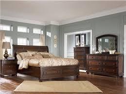 Dark Brown Wood Bedroom Furniture With Smokey Blue Walls White Bedding