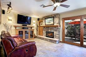 Rustic Living Room With Ceiling Fan Built In Bookshelf Slate Tile Floors