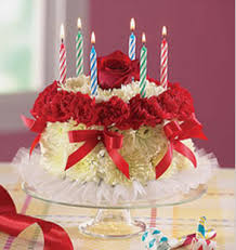 LIght yellow white and red flowers with birthday cake shape with candles PNG