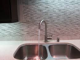 kitchen sink with marble tile back spash