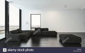 wohnzimmer mit schwarzen sofas und rechteckig pouf auf